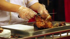 Duck being sliced Stock Footage