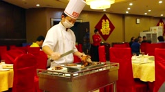 Cook slicing a typical duck in Beijing, China Stock Footage