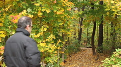 People walking through the trails in Autumn Stock Footage