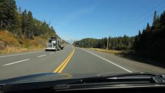 Passing truck on sunny Northern Ontario highway. Stock Footage