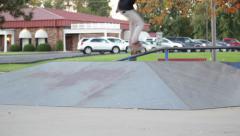 Skateboarders Shred Box Ramp At Skatepark Stock Footage