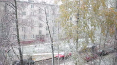 First snowfall at autumn season, trees and land over snow - stock footage
