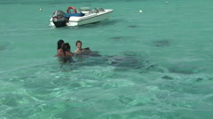 French Polynesia Tahiti Women Playing with Stingrays Stock Footage