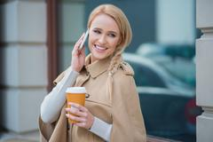 Attractive woman taking a call on her mobile Stock Photos