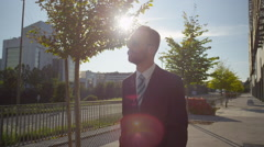 SLOW MOTION: Successful businessman walking along the business district Stock Footage