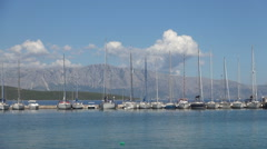 Port with many yachts moored.  Mediterranean holiday with sailing boats.. Stock Footage