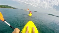 Kayaking after friend, escaping to boat and saving, 4k uhd pov Stock Footage