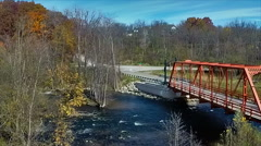 Aerial pan of autumn colors along the Huron River Stock Footage