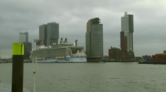 Large cruise ship Oasis of the Seas moored at cruise terminal Rotterdam Stock Footage