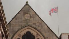 Union Flag Flying Above an old historical building - Lichfield Town Centre Stock Footage