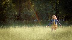 Happy Young Woman Twirls In A Circle, And Smells A Flower Stock Footage