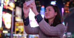 Young Asian Woman in city at night taking a selfie photo picture 4k - stock footage