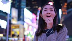 Young Asian Woman in city at night in Times Square New York Arkistovideo