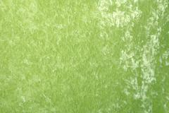 green velveteen fabric. - stock photo