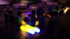Rhythmically blinking lights on a dj mixing board - stock footage