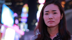 Young Asian Woman in city at night sad face portrait - stock footage