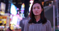 Young Asian Woman in city at night sad face portrait 4k - stock footage