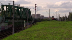 Railroad. The motrisa (railroad car) with crane passes over the bridge. Stock Footage