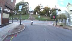 Riding motorcycle by courthouse no helmet Stock Footage