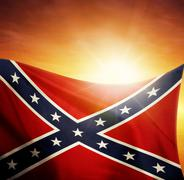 Confederate flag in front of bright sky Stock Photos