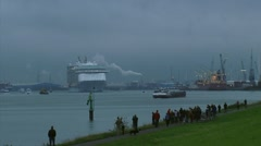 Cruise ship Oasis of the Seas outbound, approaching along Botlek seaport Stock Footage