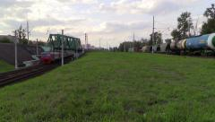 Suburban train and a freight train is followed in the same direction Stock Footage