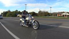 Side view motorcycle slowing down to stop Stock Footage