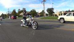 Motorcycle slowly passing Stock Footage