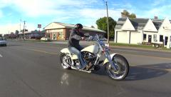 Motorcycle passing on highway Stock Footage