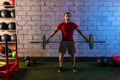 Barbell weight lifting man workout exercise gym Stock Photos