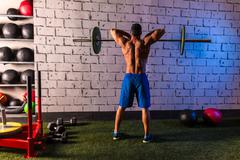 barbell weight lifting man rear view workout gym - stock photo