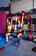 gym women barbell plates rising workout - stock photo