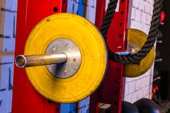 Barbells in a gym bar bells and rope Stock Photos