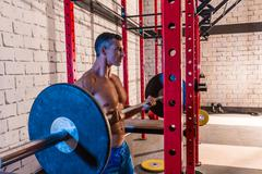 barbell weight lifting man weightlifting at gym - stock photo