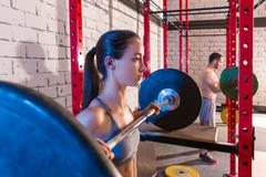 barbell weight lifting group weightlifting at gym - stock photo