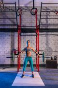 barbell weight lifting woman weightlifting at gym - stock photo