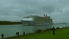 Spectators watching worlds largest cruise ship approaching, outbound + honks Stock Footage