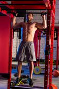 Toes to bar man pull-ups 2 bars workout Stock Photos