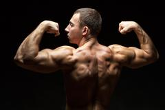 Stock Photo of ideal beautiful back muscles in men.