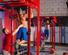 Toes to bar man pull-ups personal trainer Stock Photos