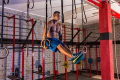 dip ring girl man muscle ups rings workout - stock photo