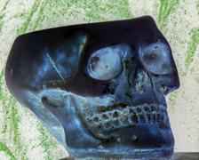 Skull above an ancient book Stock Photos