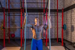 climb with two 2 ropes exercise man at gym - stock photo