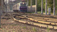 Railways passenger train. Shooting at long focus. Haze over the rails Stock Footage