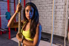 Stock Photo of climb rope exercise woman at gym