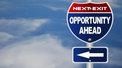 Stock Video Footage of opportunity ahead road sign with flowing clouds