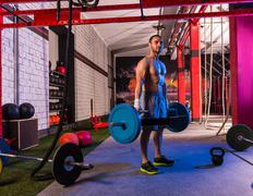 hex dead lift shrug bar deadlifts man at gym - stock photo