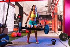 hex dead lift shrug bar deadlifts woman at gym - stock photo