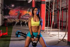 brunette girl kettlebell swing weightlifting - stock photo