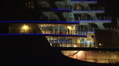 Rear deck worlds largest cruise ship Oasis of the Seas by night - outbound Stock Footage